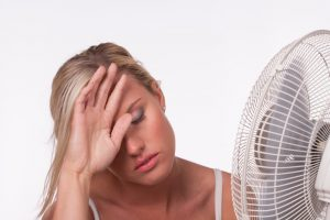 woman-with-electric-fan